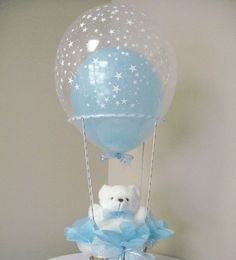 Transparent hot balloon filled with a single Blue balloon and tied to a basket with White Teddy and Blue wrapping