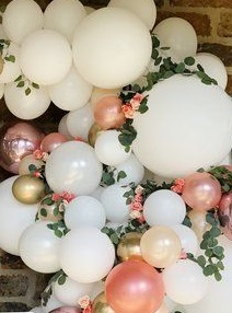 Gold white pink air balloons with flowers in between