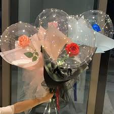 Four Transparent bobo balloons with roses inside and LED Light for Birthday