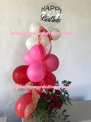 Pink red white air balloons arrangement with roses and happy birthday balloon