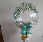 1 air bubble balloons with blue green golden balloons and leaf on balloon