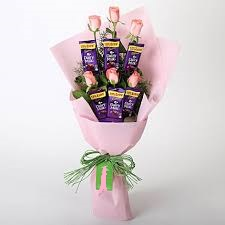 6 Pink Roses 6 dairy milk Chocolates in the same bouquet in Pink Wrapping