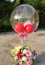3 air Balloons inside a Transparent balloon with basket of 40 flowers