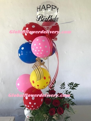 Polka dot air balloons arrangement with roses and happy birthday balloon