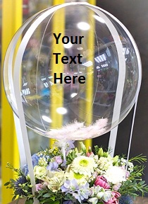 Transparent Balloon Printed WITH YOUR TEXT in 3 words only Tied with ribbons to a basket of 12 white Pink Roses