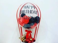 Happy Birthday Printed on Transparent Balloon stuffed with 3 black and 3 balloons Tied with ribbons to a basket containing 16 Ferrero rocher chocolates