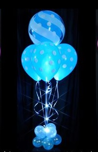 6 Blue sparkle party decoration balloons on stick arranged in a box with ribbons and small balloons