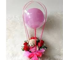 6 Red rose Teddy in basket with single pink air balloon inside a transparent Balloon
