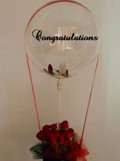 CONGRATULATIONS printed transparent balloon with 8 red roses arrangement